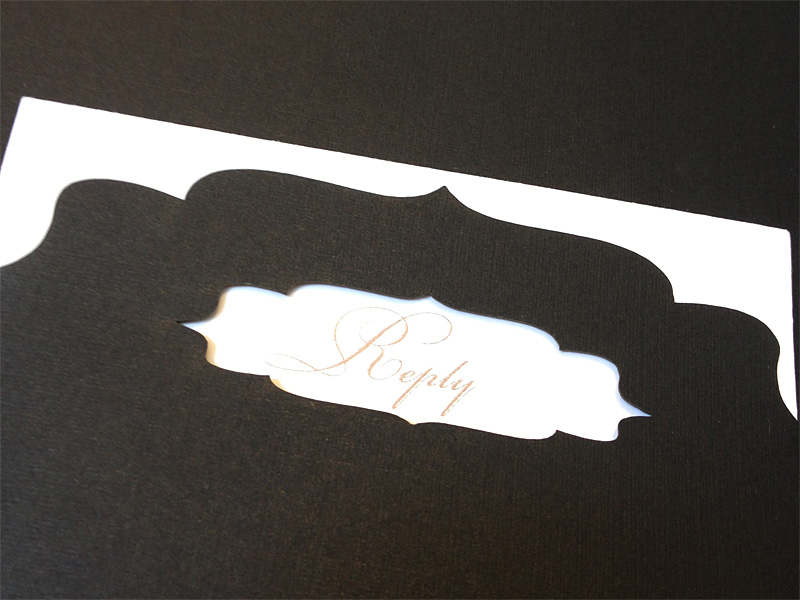Custom chantilli lace laser cut invitation gold foil and letterpress showing invitation showing reply card pocket.