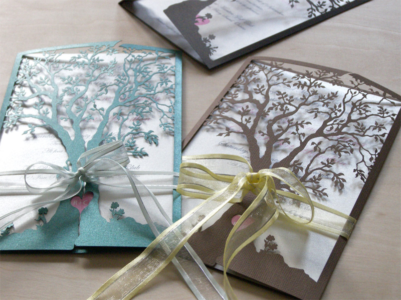Love tree laser cut wedding invitation in green and brown with ribbons