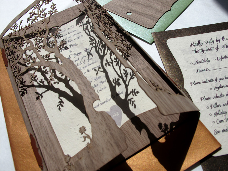 Detail of 'Love Tree' laser cut Walnut Wood wedding invitations