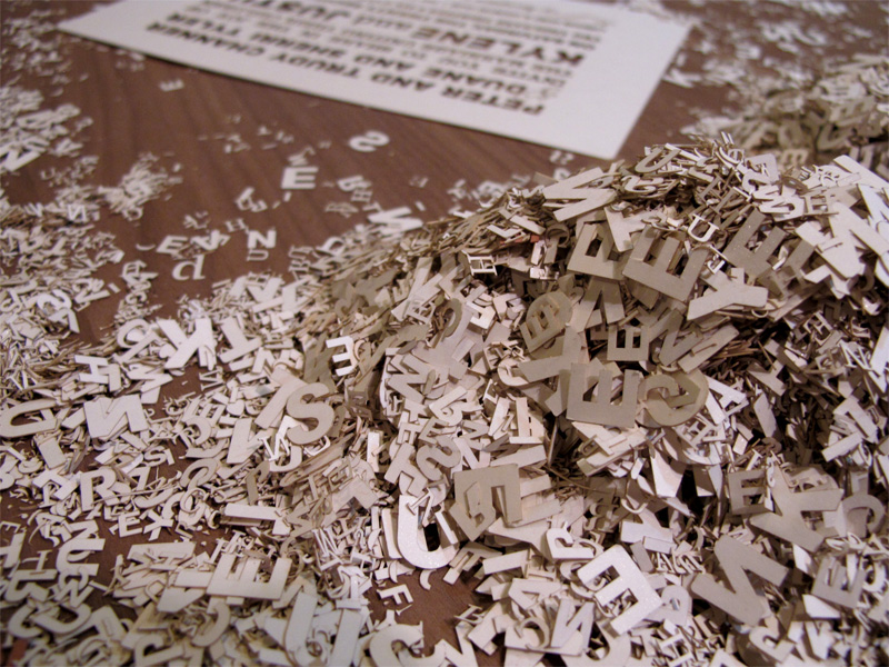 Laser cut outs of letters from wedding invitations